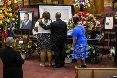 Mourners consoled each other during the public viewing before the funeral of Botham Shem Jean at the Greenville Avenue Church of Christ in Richardson, Texas. He was shot and killed by a Dallas police officer in his apartment in Dallas.
