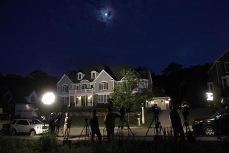 Media gather outside of Aaron Hernandez's home in North Attleboro, Massachusetts June 19, 2013. (Jessica Rinaldi For The Boston Globe)