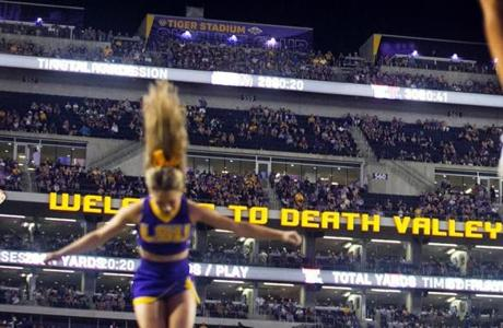 "Tracy aims for the ""D"" in the ""Welcome to Death Valley"" sign."