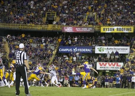 Tracy follows through on a field goal against Louisiana Tech.