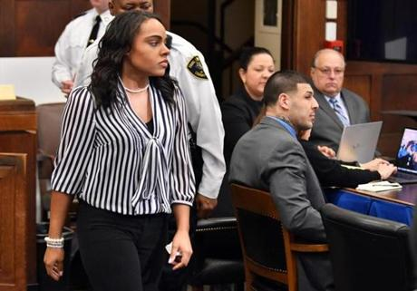 Shayanna Jenkins Hernandez, fiance´ of Former New England Patriots player Aaron Hernandez, right, walks to the witness stand to testify in Suffolk Superior Court during his trial for the July 2012 killings of Daniel de Abreu and Safiro Furtado, on Thursday, March 30, 2017 in Boston. Hernandez, who is serving a life sentence for a 2013 murder, is on trial for the murder of two men in a 2012 drive-by shooting. Josh Reynolds for The Boston Globe/Pool (Metro, Pool )