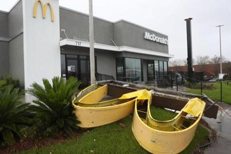 A McDonald's sign lay on the ground after it was knocked down hy Hurricane Michael as it passed through the area.