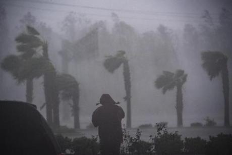 A television reporte stands watching as Hurricane Michael whips the trees Wednesday in Panama City Beach, Fla. MUST CREDIT: Washington Post photo by Jabin Botsford