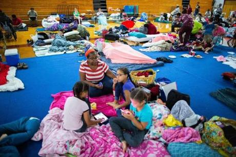 Colleen Washington and grandchildren Chylyne Sheffield, 8, (left) Chyleigh Sheffield, 10, and Chyla Sheffield, 6, waited out Hurricane Michael in a school gym in Tallahassee, Fla.