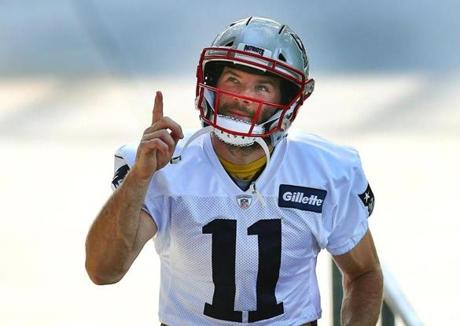 Foxborough-7/27/2018 The Patriots held their second day of training camp at the Gillette Stadium facility. Julian Edelman points up to some cheering fans as he walks up the stairs to the field. Photo by John Tlumacki/Globe Staff(sports)