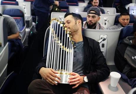 Los Angeles, Ca-- October 29 2018-Stan Grossfeld/ Globe Staff—Sox reliever Joe Kelly closed his eyes and tried to relax with some pretty sharp hardware in his lap on the Los Angeles to Boston flight.