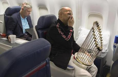 Somewhere between Los Angeles and Boston-- October 29, 2018-Stan Grossfeld/ Globe Staff---The Red Sox charter on the way back from winning the World Series in Los Angeles. Alex Cora had a well deserved laugh (right) while Sox president of baseball operations Dave Dombrowski worked at his computer.