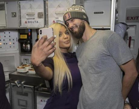 Somewhere between Los Angeles and Boston-- October 29, 2018-Stan Grossfeld/ Globe Staff---The Red Sox charter on the way back from winning the World Series in Los Angeles. Rick Porcello posed for a picture with a flight attendant.