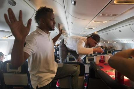 Somewhere between Los Angeles and Boston-- October 29, 2018-Stan Grossfeld/ Globe Staff---The Red Sox charter on the way back from winning the World Series in Los Angeles. Card games in the back of th plane. Xander Bogaerts and Christian Vazquez.