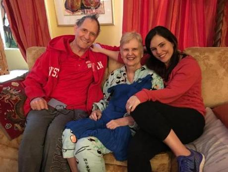 """Laura at home with her parents, Bill and Georgia Levis, in their Manhattan apartment. Laura's mother passed away this July, after a long battle with Stage 4 cancer. So they are together now."""