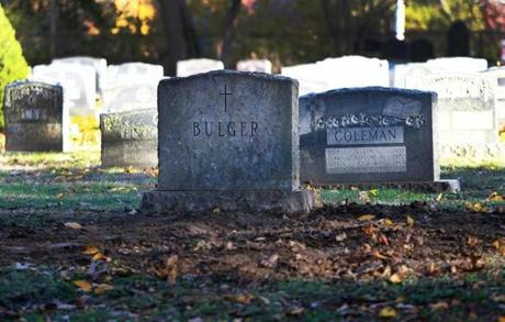 "Freshly dug up dirt was pictured in front of a headstone where James ""Whitey"" Bulger was buried at St. Joseph's Cemetery."