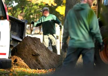 "Cemetery workers at St. Joseph's Cemetery put dirt on the burial site of James ""Whitey"" Bulger."