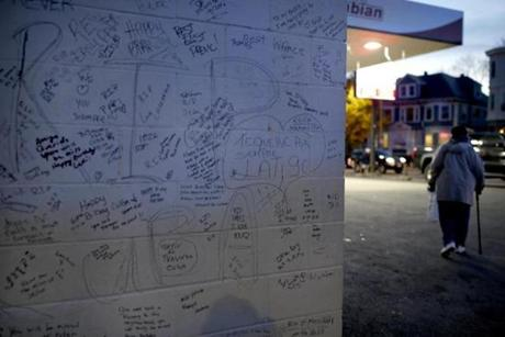Messages of tribute were written on the wall of Fabian Gas Station, 67-year-old Jose Luis Williams was fatally shot.