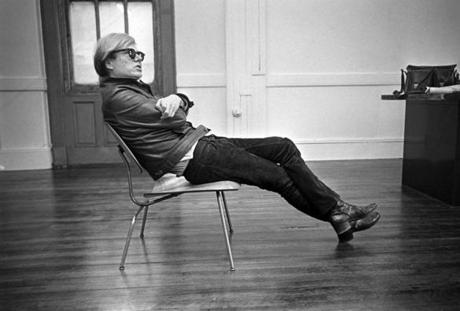 FILE -- Andy Warhol sits in his favorite chair in New York, Feb. 27, 1968. Warhol's decision to turn the spreadsheet and the publicity machine into artistic mediums has touched artists from Damien Hirst to Banksy. (Barton Silverman/The New York Times)