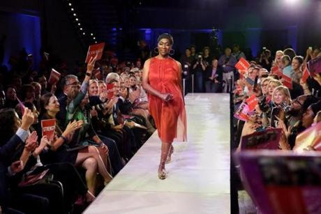 Boston, MA Ê- October 11, 2018: ÊMarie Cajuste, 58, modeled a dress, designed by Nubia Williams, during Cat Walk for BMC Cancer Care in Boston, an annual fundraiser held by Boston Medical Center. Cajuste described the night, during which she and other models nibbled on sandwiches as assistants applied makeup and styled their hair, as beautiful. At home, in her rooming house, it is easy for her mind to turn to negative thoughts, she said. At the fundraiser, she felt very positive about her future. (Craig F. Walker/Globe Staff) section: metro reporter: Kowalczyk
