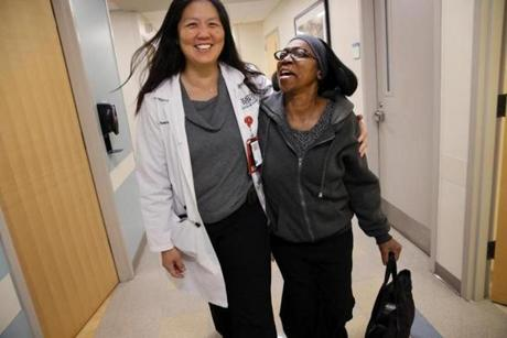 (FOR KOWALCZYK MEDICAL STORY) Boston, MA Ê- October 17, 2018: ÊOncologist Dr. Naomi Ko walked with Marie Cajuste, 58, following her appointment at Boston Medical Center in Boston. Ko had good news -- finally - for her patient. The results of a recent PET-CT scan indicated that Cajuste was cancer free, following almost two years of treatment for stage 3 breast cancer and a later recurrence. Ko, however, informed Cajuste that she would need to receive maintenance treatments to keep her cancer at bay, perhaps for the rest of her life. Ê(Craig F. Walker/Globe Staff) section: metro reporter: Kowalczyk