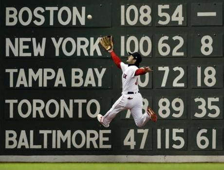 Boston, MA - 10/24/2018 - Andrew Benintendi makes a leaping catch against the wall hit by Brian Dozier in the fifth inning of Game 2 of the World Series. The Boston Red Sox host the Los Angeles Dodgers in Game 2 of the World Series at Fenway Park. (Jim Davis/Globe staff)