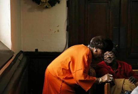 A woman stopped to chat with Barbara Washington (right) as she left Sunday service at the Eliot Congregational Church.