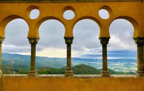 SINTRA, Portugal, May 29. The 19th century Pena Palace in Sintra is a photographer's dream. On a clear day the views are spectacular. On a foggy day they aren't quite as breathtaking, so I opted to shoot the landscape through these arches.