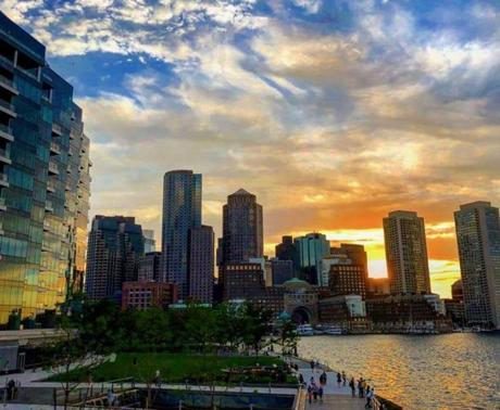 BOSTON, July 6. I'm generally not a fan of the Seaport. Its bland glass buildings remind me of a Dallas office park. But behind all of those buildings is the stunning Harbor Walk, a perfect way to spend a summer night.