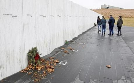 Visitors walked past the Wall of Names at the Flight 93 National Memorial near Shanksville, Pa. Signs were posted on all doors stating that the facilities were closed.