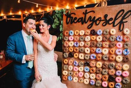 Maple bacon, Fruity Pebbles, and the couple's favorite, chocolate butter crunch, were among the flavors on Molly and Mike Shaw's DIY doughnut wall at their wedding reception.