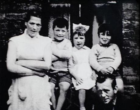"A reproduction of a black and white family handout photograph taken some time before December 1972 and reproduced on May 3, 2014 with the permission of Helen McKendry shows murdered woman Jean McConville (L) with some of her 10 children, including eldest daughter Helen McKendry (2R), in Northern Ireland. Jean McConville, 37, a mother of 10, was abducted by the IRA in front of her children at her Belfast home in December 1972, shot dead and then secretly buried. She was accused of passing information to the British army. Northern Ireland police on May 2, 2014 obtained an extension to question detained republican leader Gerry Adams over the notorious murder. RESTRICTED TO EDITORIAL USE - MANDATORY CREDIT "" AFP PHOTO / FAMILY HANDOUT / HELEN MCKENDRY "" - NO MARKETING NO ADVERTISING CAMPAIGNS - DISTRIBUTED AS A SERVICE TO CLIENTS - RESTRICTED TO SUBSCRIPTION USE NO SALES-/AFP/Getty Images"