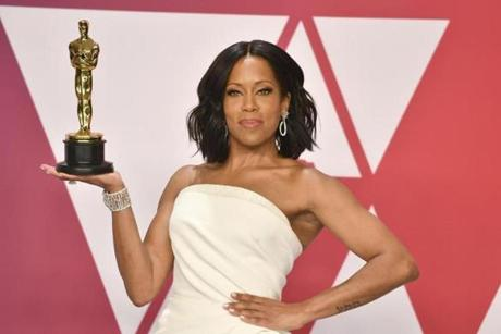 Regina King poses with the award for best performance by an actress in a supporting role for