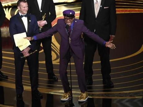 Charlie Wachtel, left, and Spike Lee accept the award for best adapted screenplay for