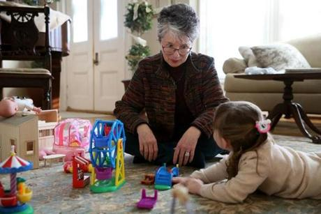 Diane DiGennaro played with her granddaughter. She and her husband, David Spitz, have guardianship of the girl.