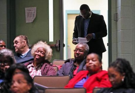 3-14-19: Mattapan, MA: At a community meeting held at the Mildred Avenue Community Center, Tito Jackson, forner Boston mayoral candidate is pictured looking over the handout given to attendees concerning the proposed opening of a cannabis shop as he enters the auditorinum. (Jim Davis /Globe Staff).
