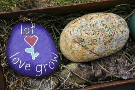 """Let love grow"" is painted on a rock outside the front door of the Resiliency Center of Newtown."