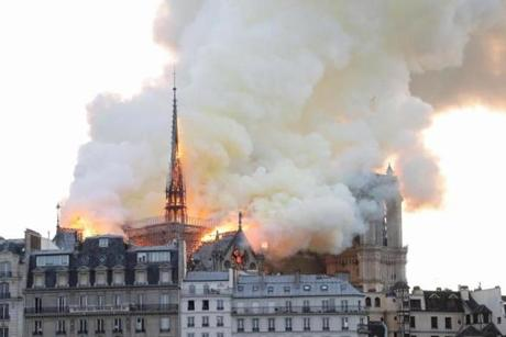 Smoke and flames rise during a fire at the landmark Notre Dame Cathedral in central Paris on April 15, 2019, potentially involving renovation works being carried out at the site, the fire service said. (Photo by FRANCOIS GUILLOT / AFP)FRANCOIS GUILLOT/AFP/Getty Images