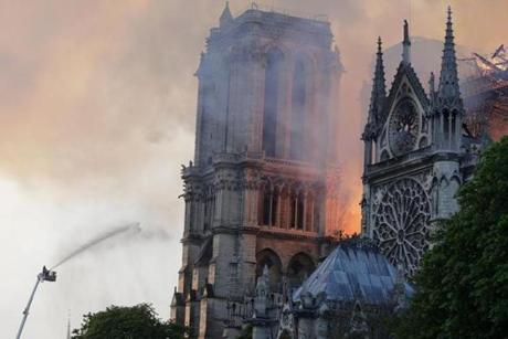 Firefighters douse flames rising from the roof at Notre Dame Cathedral in Paris on April 15, 2019. - A fire broke out at the landmark Notre Dame Cathedral in central Paris, potentially involving renovation works being carried out at the site, the fire service said. (Photo by Thomas SAMSON / AFP)THOMAS SAMSON/AFP/Getty Images