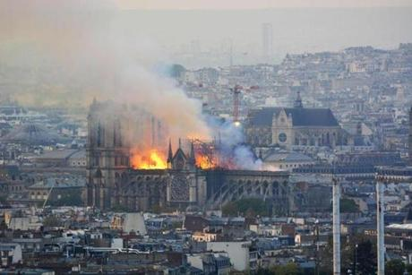 Smoke and flames rise during a fire at the landmark Notre Dame Cathedral in central Paris on April 15, 2019, potentially involving renovation works being carried out at the site, the fire service said. - A major fire broke out at the landmark Notre Dame Cathedral in central Paris sending flames and huge clouds of grey smoke billowing into the sky, the fire service said. The flames and smoke plumed from the spire and roof of the gothic cathedral, visited by millions of people a year, where renovations are currently underway. (Photo by Hubert Hitier / AFP)HUBERT HITIER/AFP/Getty Images