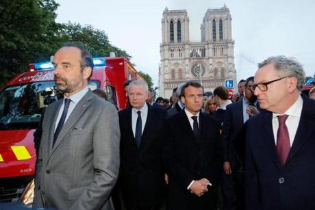 French Prime Minister Edouard Philippe (left) and French President Emmanuel Macron (third from left) gathered near the entrance of the Notre Dame Cathedral.