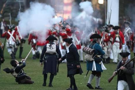 APRIL 15, 2019 --LEXINGTON, MA - Lexington Minute Men come under fire by Her Majesty's Army on Lexington's Battle Green, depicting the skirmish that took place on Lexington common early on the morning of April 19, 1775. (Joanne Rathe/ Globe Staff)