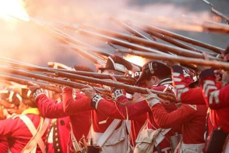 APRIL 15, 2019 --LEXINGTON, MA - A sea of fire as British Revolutionary War re-enactors fire one last round after Battle on Lexington Green. . (Joanne Rathe/ Globe Staff)