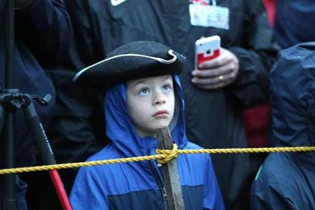APRIL 15, 2019 --LEXINGTON, MA - Aidan Davis, 7, of East Long Meadow wears his Tricorn hat as he takes in his first re-enactment of the Battle of Lexington early Monday morning. (Joanne Rathe/ Globe Staff)