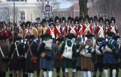 APRIL 15, 2019 --LEXINGTON, MA - Lexington Minute Men face the British soldiers as re-enactors depict the skirmish that took place on Lexington common early on the morning of April 19, 1775. (Joanne Rathe/ Globe Staff)