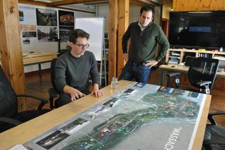 James Jarzyniecki (left) and Ben Sosne (right) look at a map that shows current cultural attractions in North Adams and Williamstown and depicts other possible projects that could occur in the region, including the Extreme Model Railroad and Contemporary Architecture Museum that's slated to open in North Adams. The map is pictured as displayed in EMRCA developers' North Adams office on Thursday, Jan. 18, 2018. (Shannon Young | The Republican)