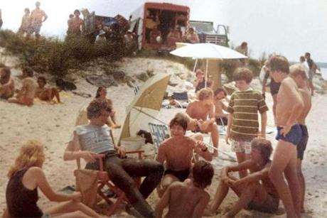 "A photo of people gathered around director Steven Spielberg on the ""Jaws"" set."