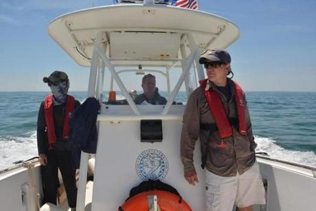 The team in late June for the first shark-tagging trip in Cape Cod Bay. From left: Megan Winton and Cynthia Wigren (in rear) of the  Atlantic White Shark Conservancy, Provincetown shellfish constable Steve Wisbauer, and state shark expert Greg Skomal.