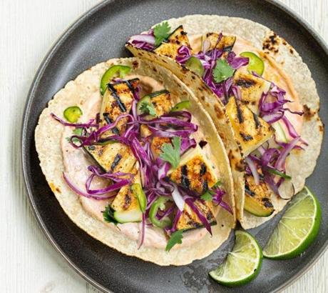 Grilled zucchini tacos with cabbage slaw and chipotle crema.