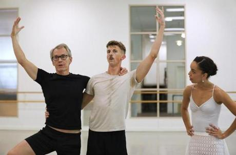 "Boston, MA 8/15/19 Boston Ballet dancers Chyrstyn Fentroy (cq), right, and Matthew Slattery (cq) rehearse ""Bach Cello Suites"" (cq) with choreographer Jorma Elo (cq), left, in the Boston studio. Photo by Pat Greenhouse/Globe Staff Topic: 22Fentroy Reporter: Marella Gayla"