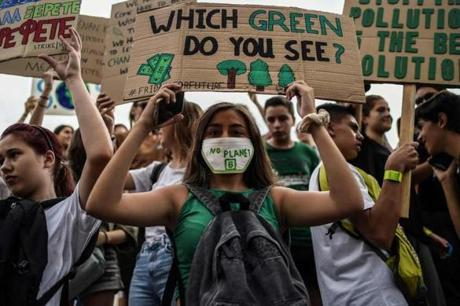 "People holding placards reading messages for the safeguard of the environment take part in a demonstration rally in front of the Greek Parliament during the ""Fridays for climate"" to protest against climate change in in Athens on September 20, 2019. (Photo by ANGELOS TZORTZINIS / AFP)ANGELOS TZORTZINIS/AFP/Getty Images"