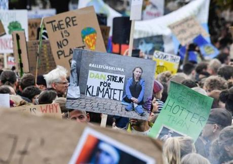 "A protester holds a sign depicting Swedish environment activist Greta Thunberg during the ""Fridays for Future"" demonstration at the Brandenburg Gate in Berlin as a protest for climate action on September 20, 2019, as part of a global climate action day. (Photo by John MACDOUGALL / AFP)JOHN MACDOUGALL/AFP/Getty Images"