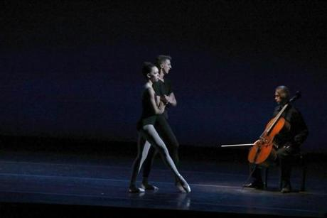 "Becket, MA 8/24/19 Boston Ballet dancer Chyrstyn Fentroy (cq) performs in the company's ""Bach Cello Suites,"" at Jacob's Pillow (cq) in Becket. She is partnered with Matthew Slattery (cq). The cellist is Sergey Antonov (cq). Photo by Pat Greenhouse/Globe Staff Topic: 22Fentroy Reporter: Marella Gayla"