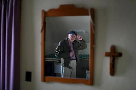 Middleborough-10/31/19- Russell Pittsley, age 99, is one of the last of a generation of World War ll veteransHe puts on his Army jacket he wore and WW ll and adjusts his cap in his bedroom mirror. . He still serves his community as a member of the honor guard. Was was in the Army infantry in the Pacific theatre in the war. Photo by John Tlumacki/Globe Staff(metro)