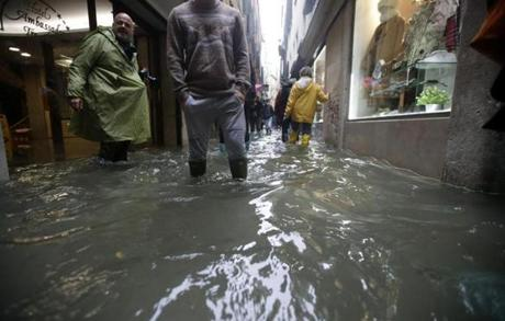 People waded through high tide in a flooded Venice, Italy.